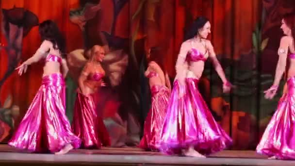Six girls dance on stage