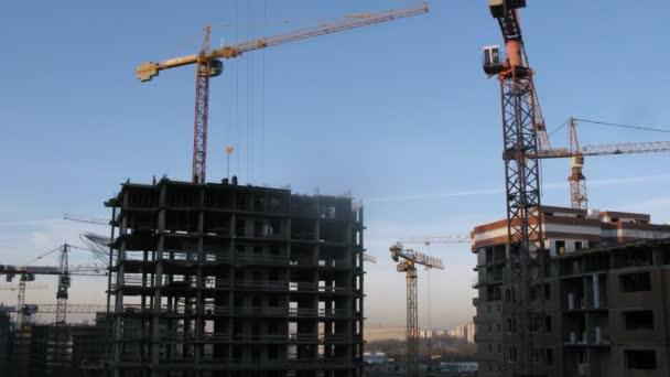 Crane moving construction panel