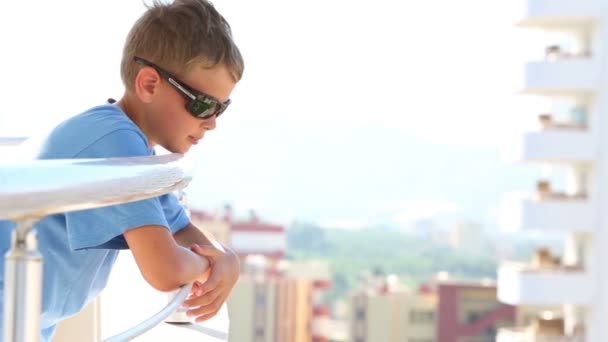 Little boy standing on balcony