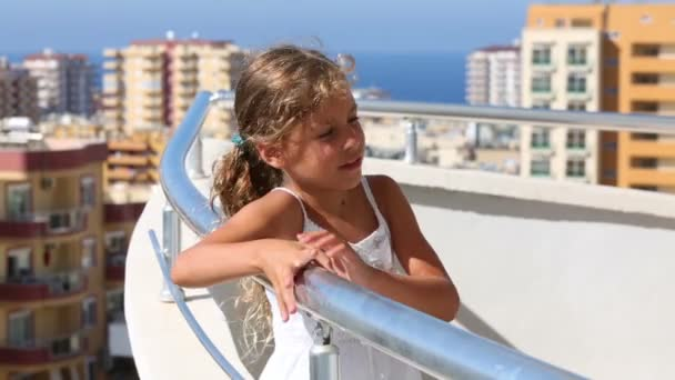 Little girl standing on balcony