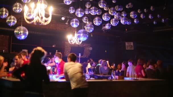 People buy drinks in bar