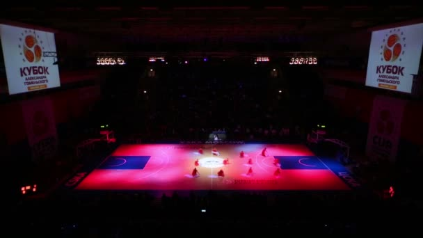Cheerleaders dancing on basketball court in tournament