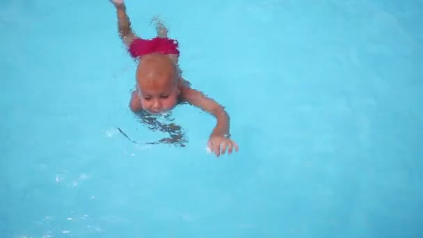 Little boy in blue pool