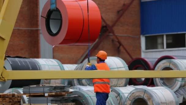 Man in helmet loading coils