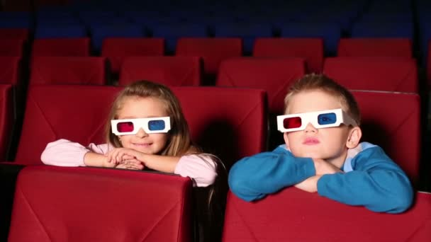 Girl and boy in 3D glasses in cinema