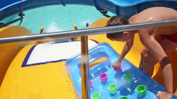 Boy having fun on water slide