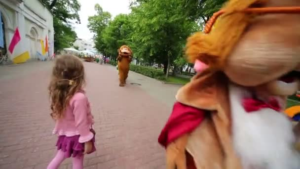 Actors dressed in cartoon characters