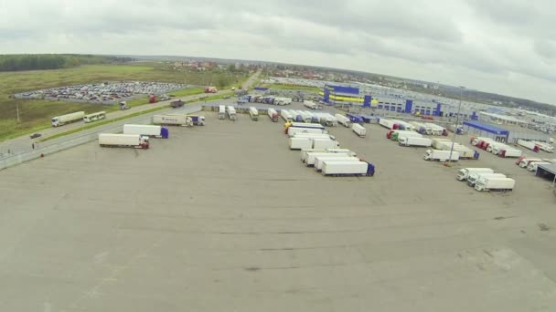 Big parking lot with many trucks