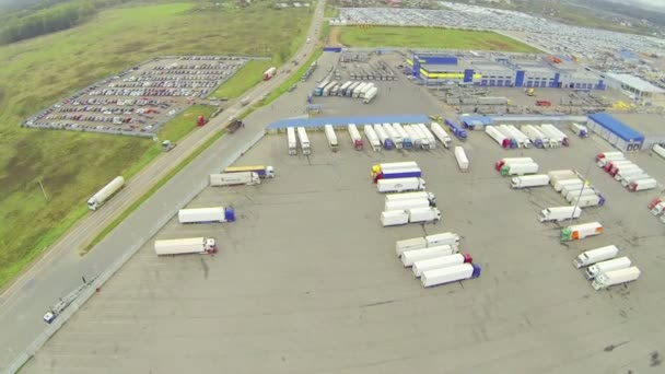 Big parking lots with cars and trucks