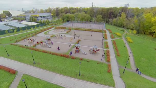 Parents with kids get rest on playground