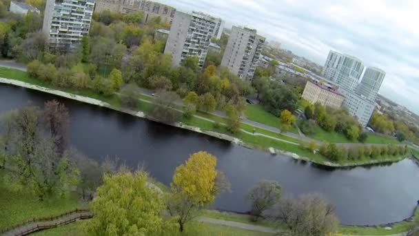 Park near Cherkizovsky pond at autumn day in Moscow