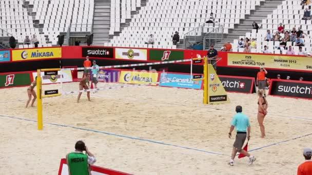 Beach volleyball match on court