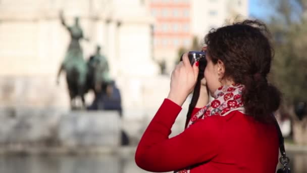 Woman photographs monument to Cervantes