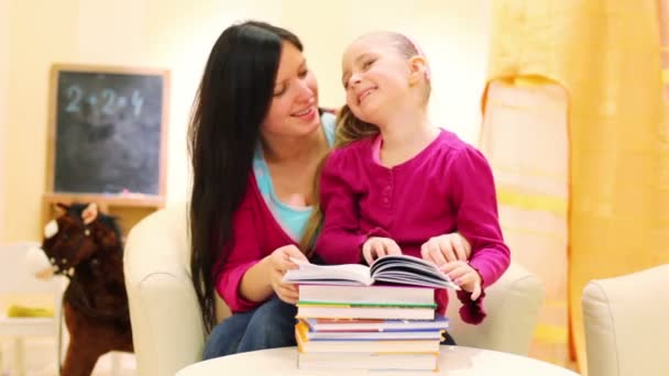 Mother and daughter read book