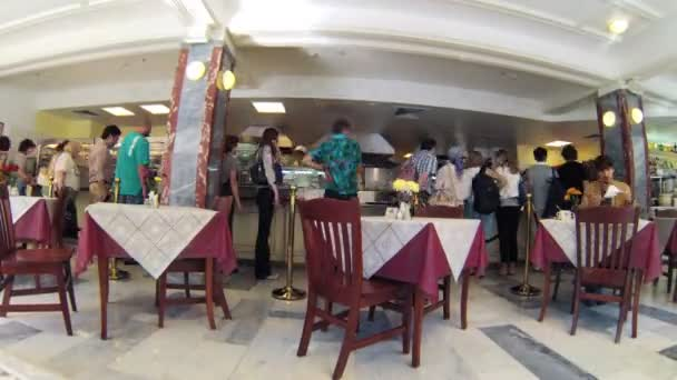 People in self served restaurant