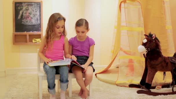 Two little girls reading