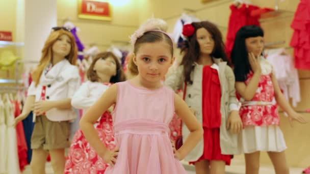Beautiful girl in pink dress posing