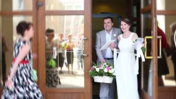 Newlyweds out of registrars office