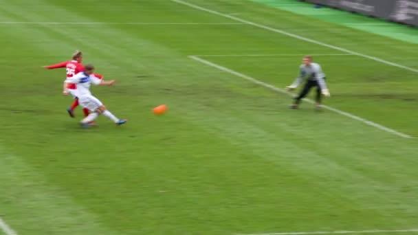 Player scores goal at football match