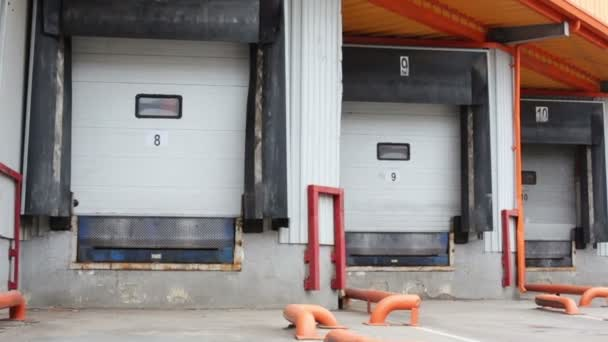 Row of gates for trucks on large warehouse