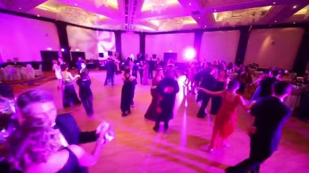 Pairs dancing at masquerade ball