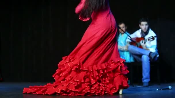 Woman in red dress dances