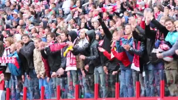 Fans applaud at football match