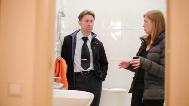 Real estate agent showing bathroom