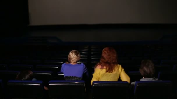 discussing people in dark hall cinema