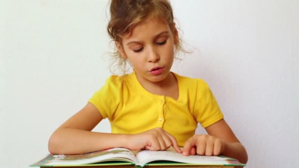 Little girl learns to read book