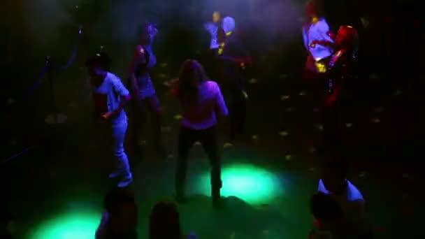Group of dancing people at dancefloor