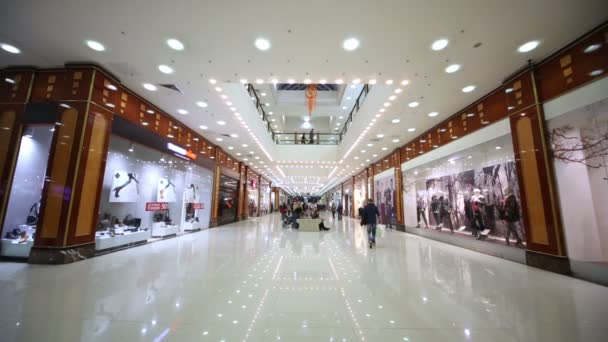 People in shopping gallery and entertainment center