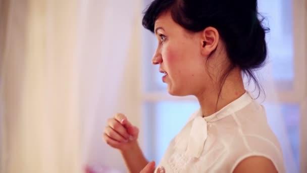 Beautiful brunette woman in white blouse