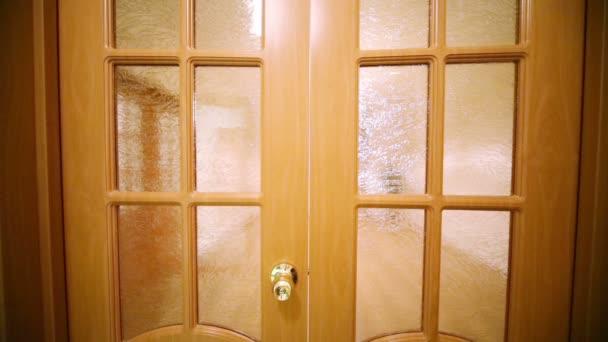Opening wooden doors to small room