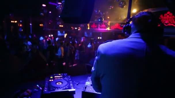 People dance in nightclub Base