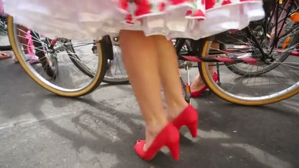 Female legs in red heels dance