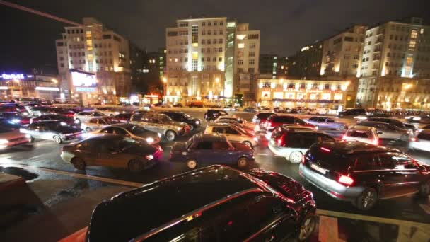 Cars stand in evening traffic jam