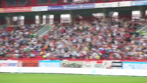 Fans raise hands on match  at Stadium.