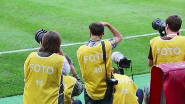 Back of photographers on match at Lokomotiv Stadium
