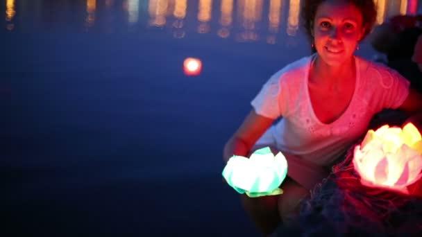 Smiling woman with water lantern