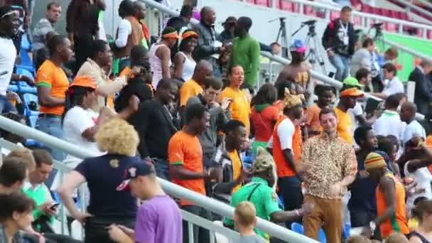 Fans dance on match