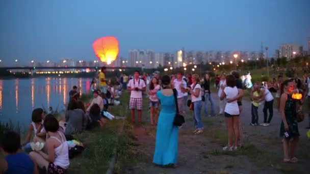 People launch air lantern
