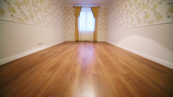 Small empty room with curtains on window
