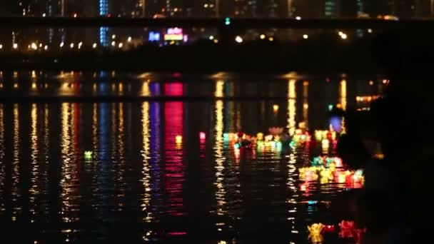 Many colored water lanterns in water