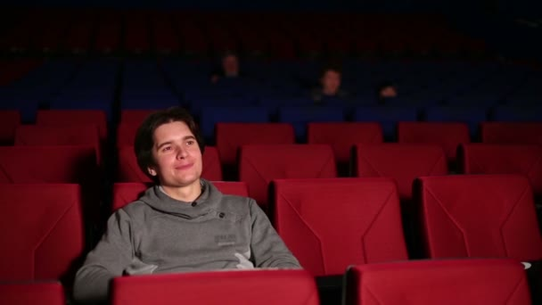 Young man at movie theater