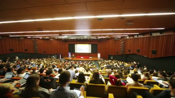 People and speaker on stage at Global Youth