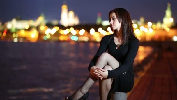 Meditative girl sitting cross-legged