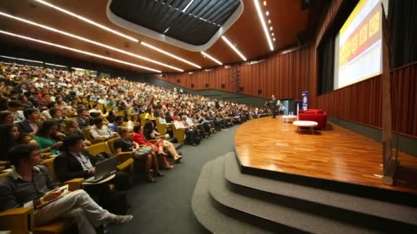 Speaker in auditorium at Global Youth