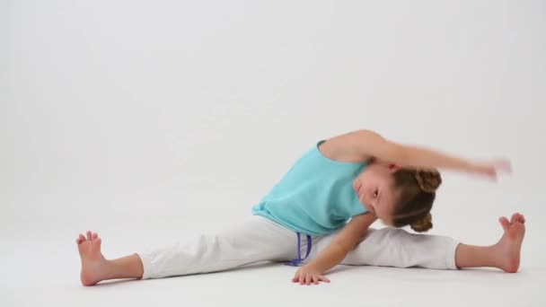 Little girl makes gymnastic exercise
