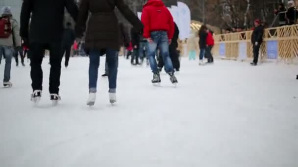 People have rest at skating rink